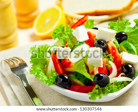 Greek vegetable salad with feta cheese, top view - stock photo