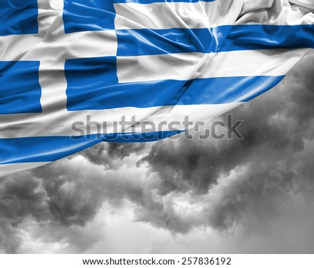Greek waving flag on a bad day - stock photo