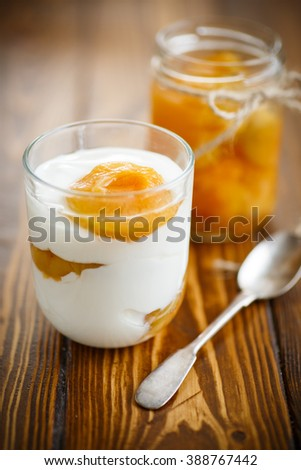 Greek yogurt with canned apricots in a glass  - stock photo