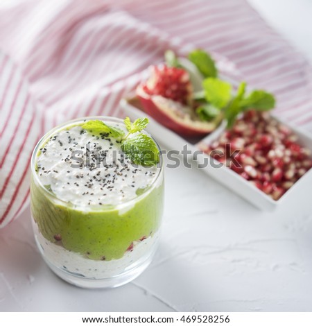 Greek yogurt with spinach smoothie on the white background