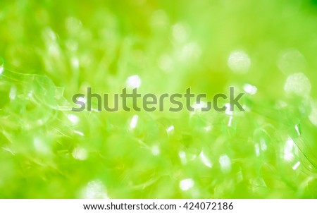 Green abstract background with bokeh hexagonal shape.
