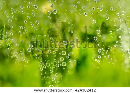 green abstract background with sparkle water drops on glass for background or backdrop. Sparkle water background. Natural green water background - stock photo