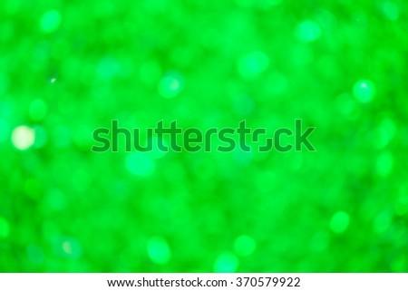 Green abstract glitter bokeh lights. defocused lights background. - stock photo