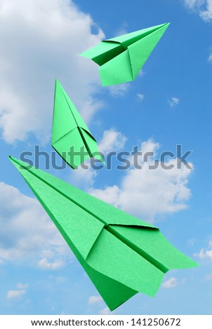 Green airplanes against blue sky - stock photo