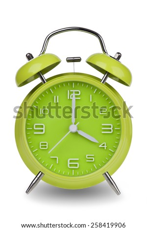 Green alarm clock with the hands at 4 am or pm isolated on a white background. One of a set of 12 images showing the top of the hour starting with 1 am / pm and going through all 12 hours - stock photo