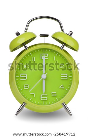 Green alarm clock with the hands at 6 am or pm isolated on a white background. One of a set of 12 images showing the top of the hour starting with 1 am / pm and going through all 12 hours - stock photo
