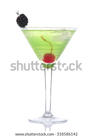 Green alcohol cosmopolitan cocktail decorated with maraschino cherry and blackberry in martini cocktails glass isolated on a white background  - stock photo