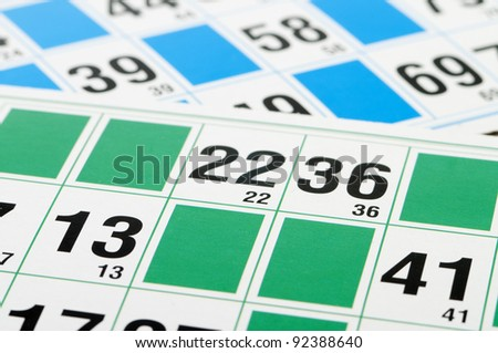 Green and blue Bingo cards and number thirteen - stock photo