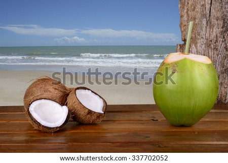 Green and Brown Coconuts at the beach - Bahia, Brazil - stock photo