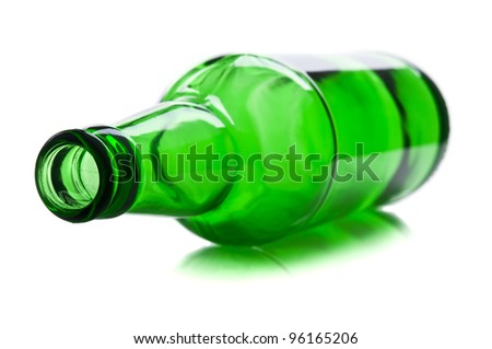green and glass bottle isolated on a white background - stock photo