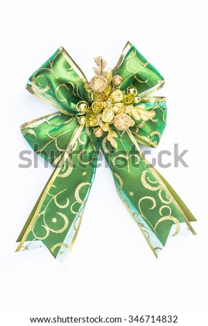 Green and gold color ribbon for christmas and new year gift decoration isolated on white background: Close up shiny satin fabric texture bow green colour for card and souvenir decorative ornament  - stock photo