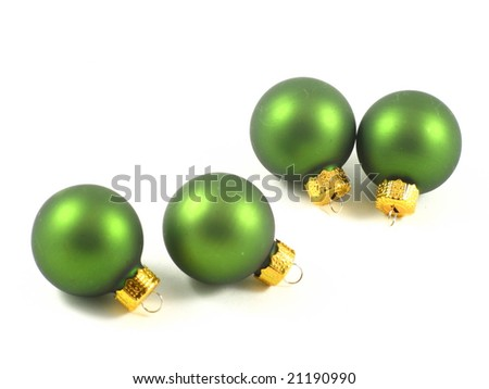 Green and Gold Holiday Christmas Tree Ornaments Arranged and Isolated on a White Background