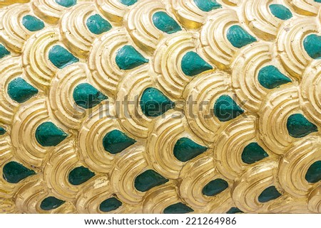 Green and gold serpent statue for pattern and background. - stock photo