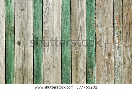 Green and gray wooden fence texture. Background and texture. - stock photo