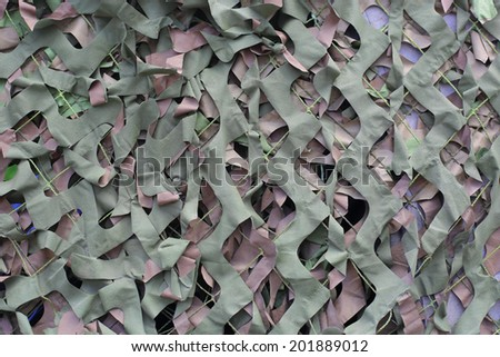 green and grey camouflage net - stock photo