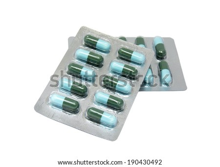 Green And Light Blue  Capsule In Transparent Blister Pack - stock photo