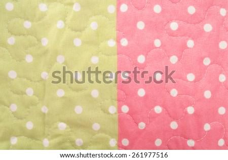 Green and pink polka dot fabric - stock photo