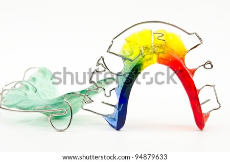 green and rainbow colored braces