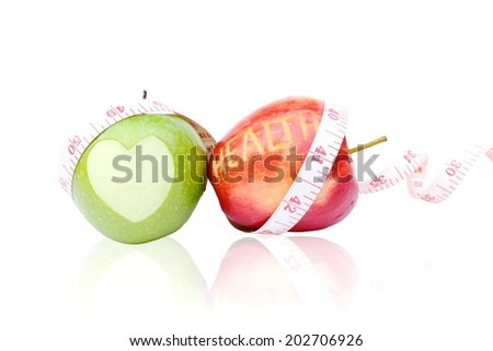 Green and red apple isolated on white background and measuring tape wrapped around.  - stock photo