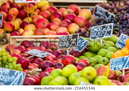Green and red apples in local market in Copenhagen,Denmark. - stock photo