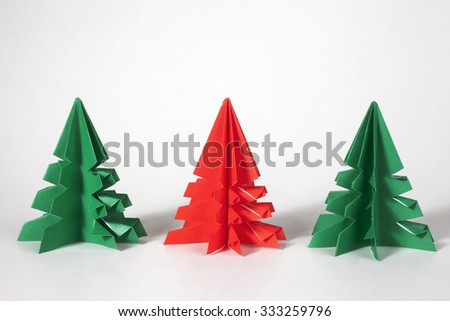 Green and red origami  trees. Christmas decoration trees.