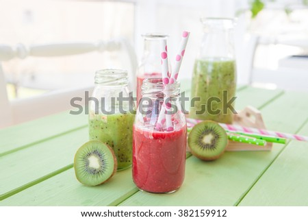 Green and red smoothies with kiwi and chia seeds - stock photo