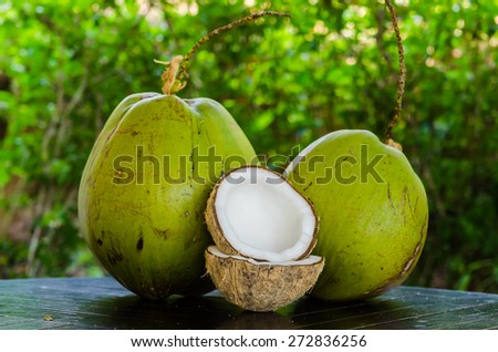 Green and ripe coco on the table - stock photo