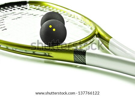 Green and silver squash racket and ball on a white background with space for text - stock photo