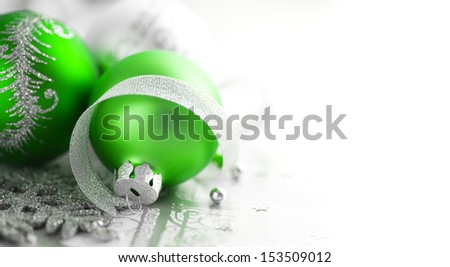 Green and silver xmas decoration with copy space - stock photo