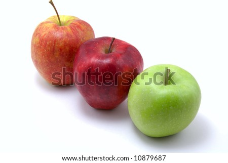 green and two red apples, isolated