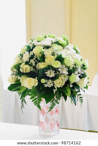 Green and white bouquet of flowers ready for wedding ceremony.