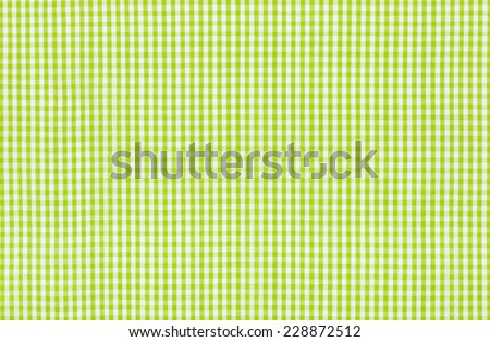 Green and white checkered fabric - stock photo