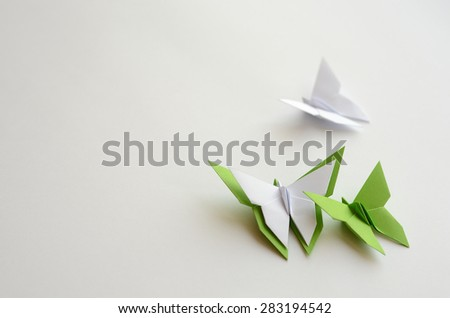 Green and white origami butterflies on white background - stock photo