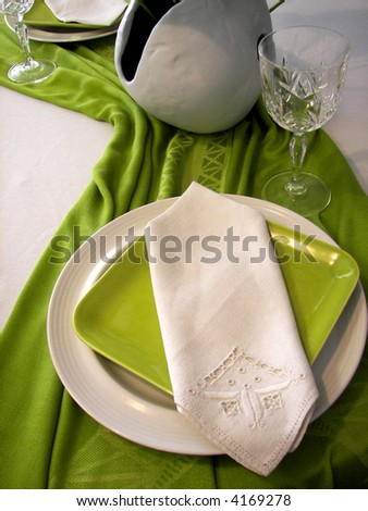 green and white place setting - stock photo