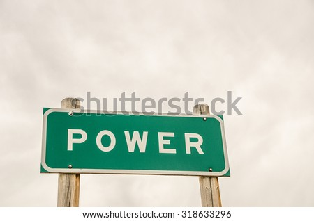 Green and white sign for power representing authority, control, influence, and strength with plenty of room for your message. - stock photo