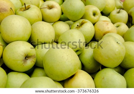 Green and yellow apples at market