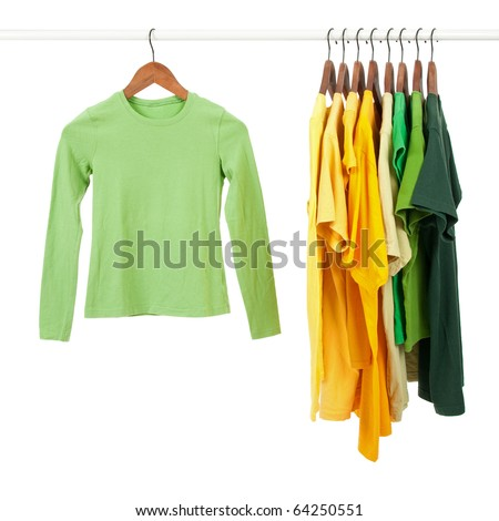 Green and yellow casual shirts on wooden hangers, isolated on white.