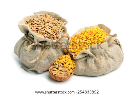 green and yellow lentils in the sacks and spoon wooden isolated on white background - stock photo