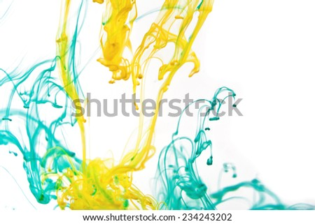 Green and yellow liquid in water making abstract forms  - stock photo