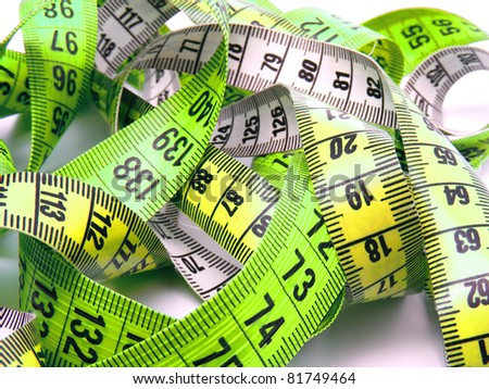Green and yellow measuring tape