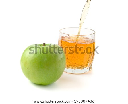 green apple and apple juice in glass isolated on white background