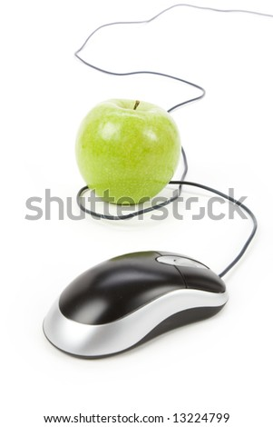 green apple and computer mouse, concept of online learning - stock photo