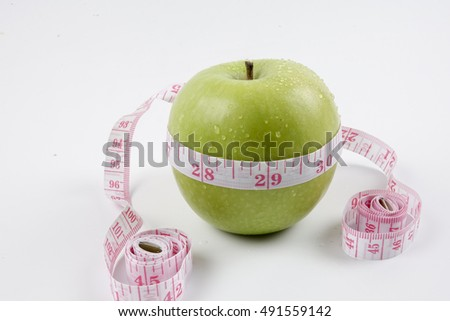 Green apple and measuring tape. Diet concept
