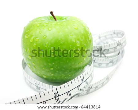 Green Apple and measuring tape on white background - stock photo
