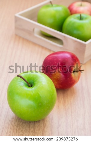 Green apple and red apple