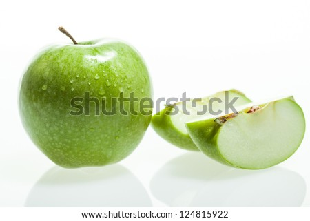 Green apple and slice on white background - stock photo