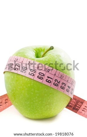 Green apple and tape measure isolated on a white