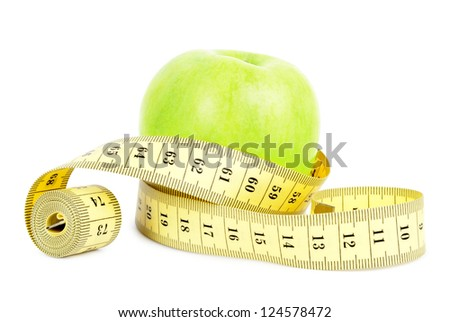Green Apple and tape measure isolated on white - stock photo
