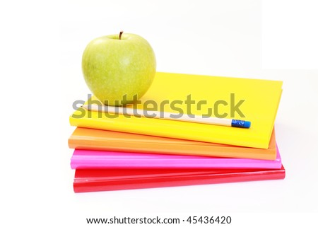 green apple books on white - back to school - stock photo