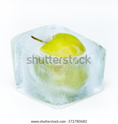 Green apple frozen in the ice cube